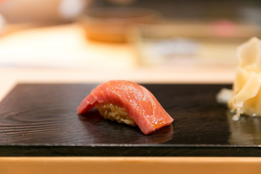 Eating Otoro sushi during your luxury travel to Japan