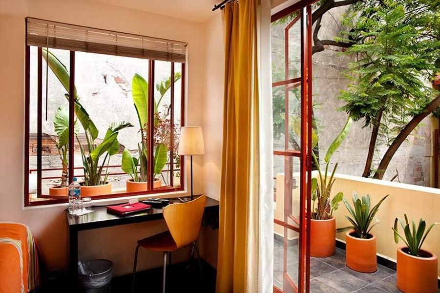 Quiet and picturesque, the Red Treehouse Treehouse Room is a great place to stay in Mexico City for solo travelers
