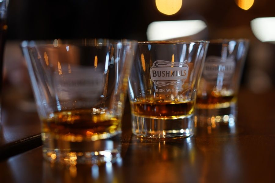 Sipping whiskey at Bushmills Distillery is one of the coolest things to do in Ireland
