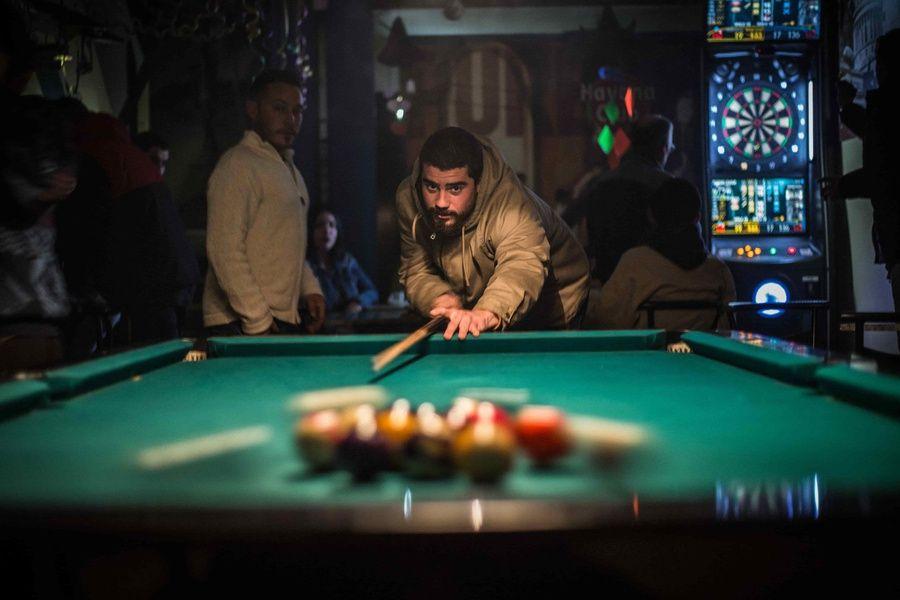 local cuban playing pool at a bar in cuba
