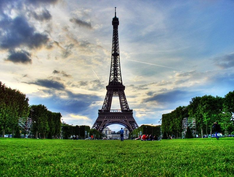 Picnicking under the Eiffel Tower is a fun thing to do in France