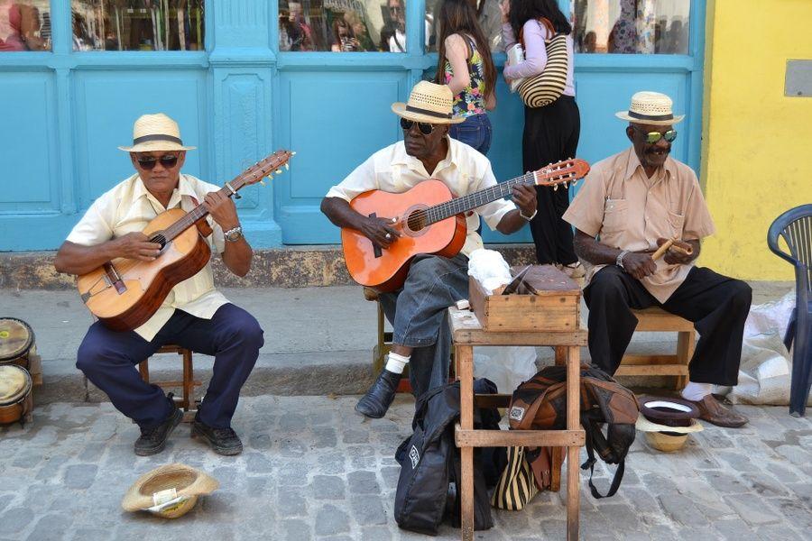 men playing guitar local guide things to do in Havana Cuba