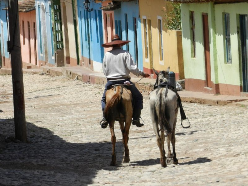 man riding horse in cuba