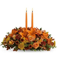 Thanksgiving flowers centerpieces orange lily and candle flowers centerpiece