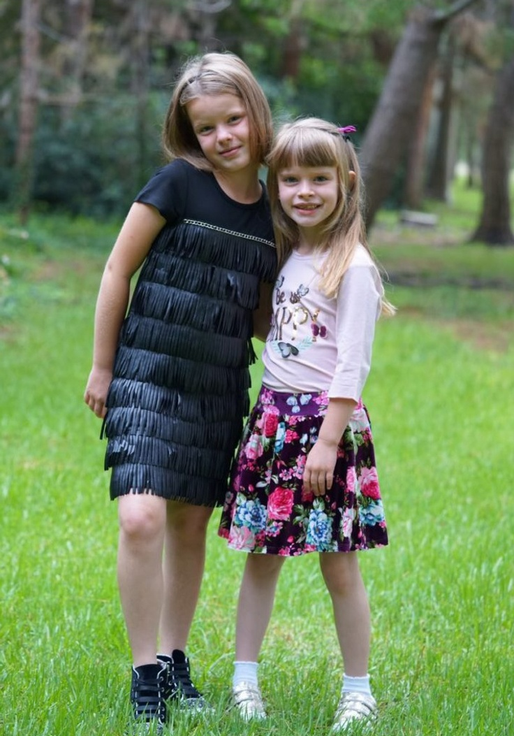 Two girls in kidpik outfits