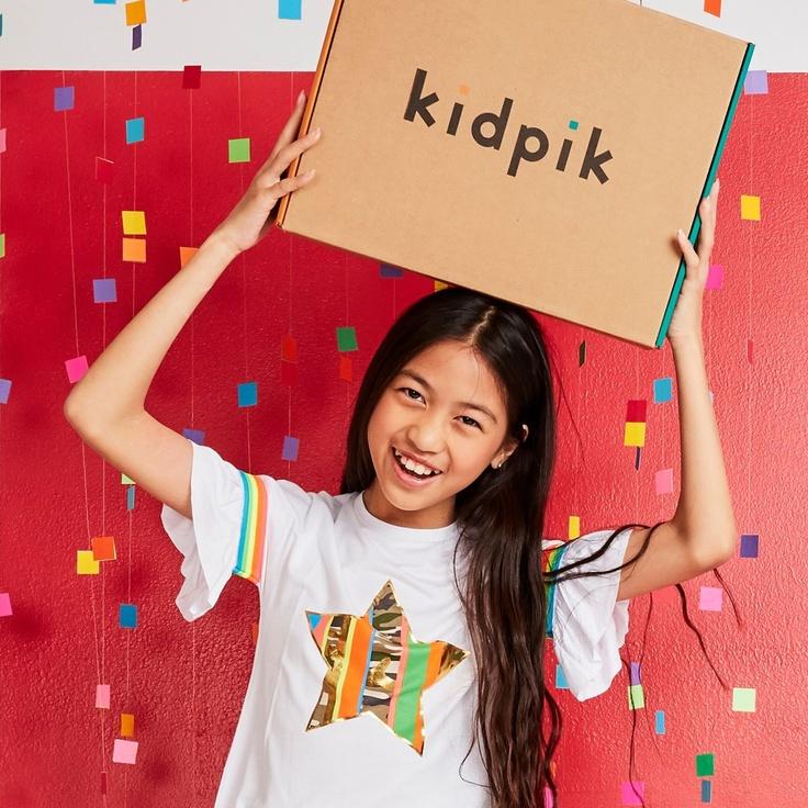 girl holding kidpik subscription box