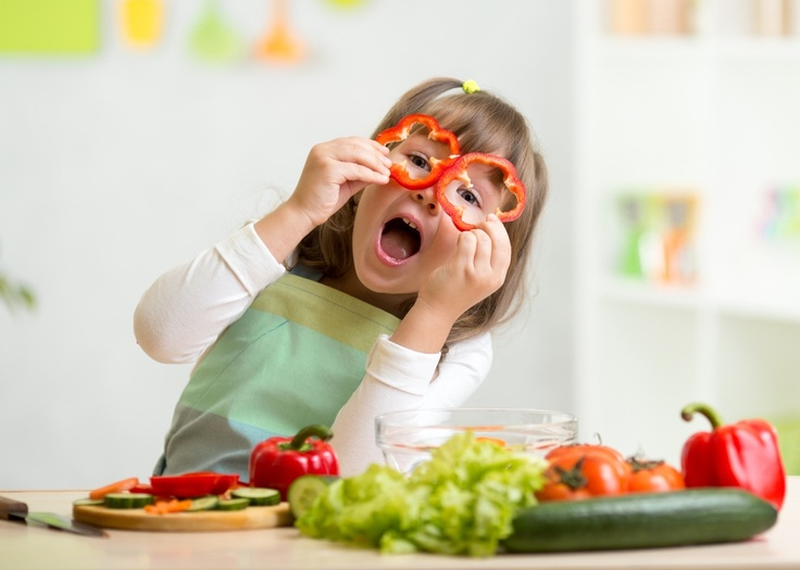 girl in kids clothes cooking