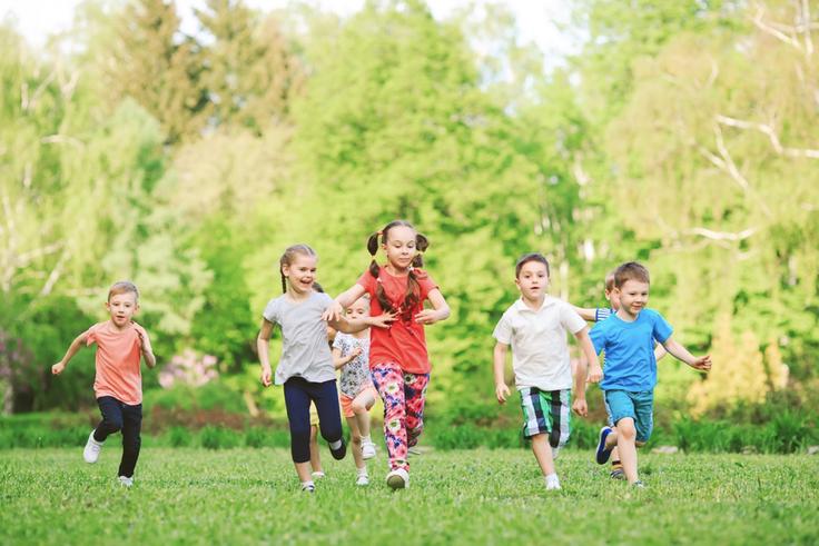 Children running through a field