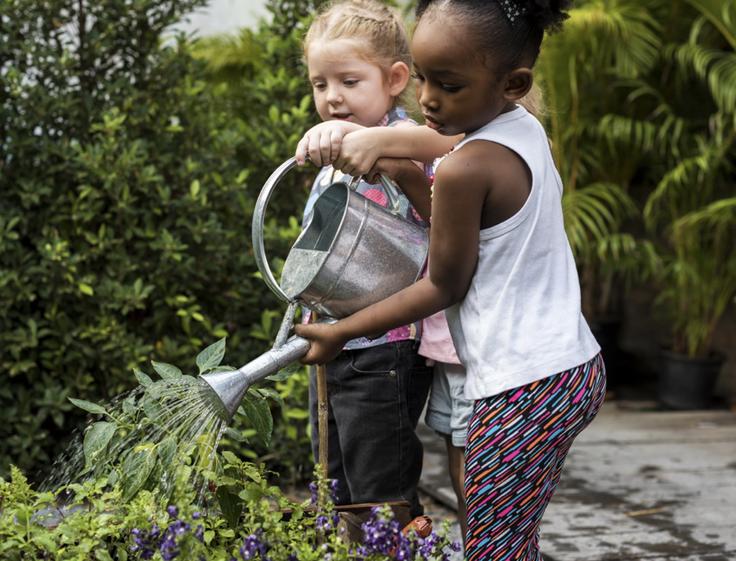 2 girls gardening
