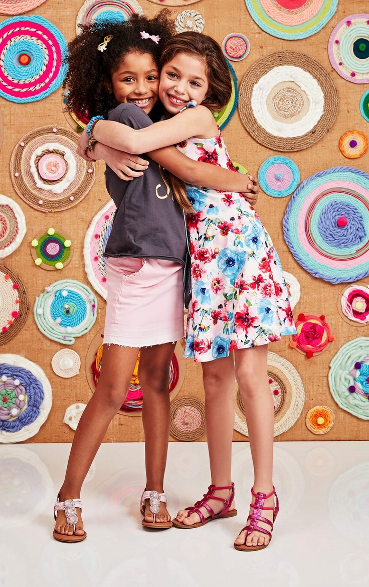 Two girls hugging in their summer kidpik outfits