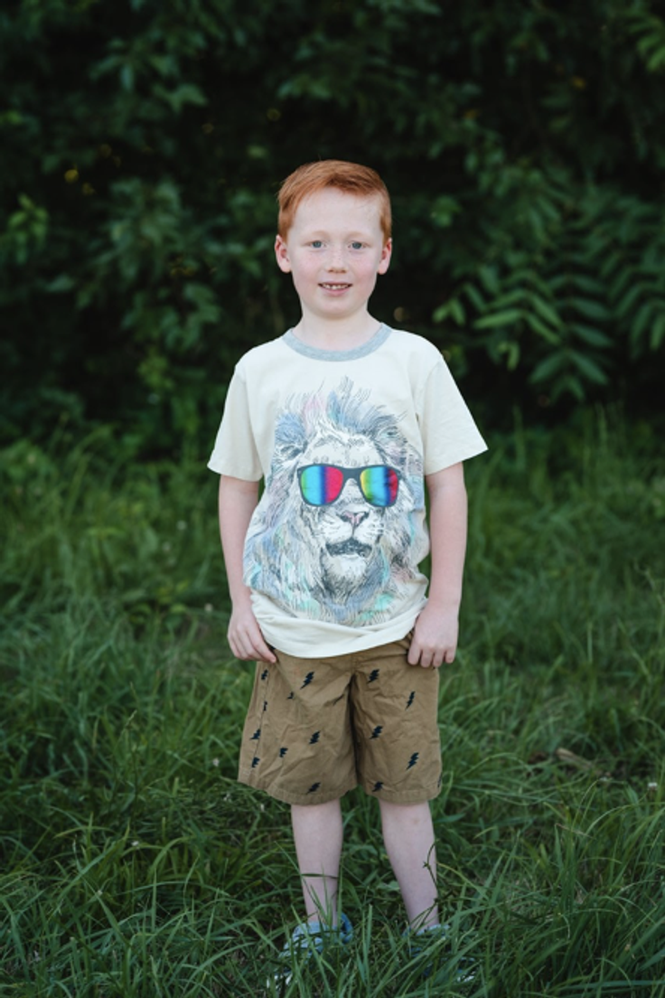 boy in kids subcription clothes