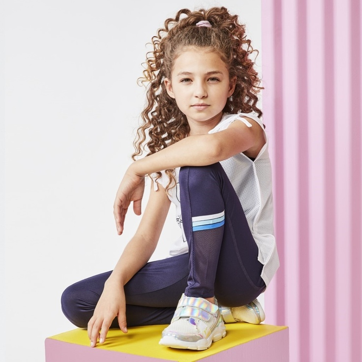 Girl in kidpik clothes