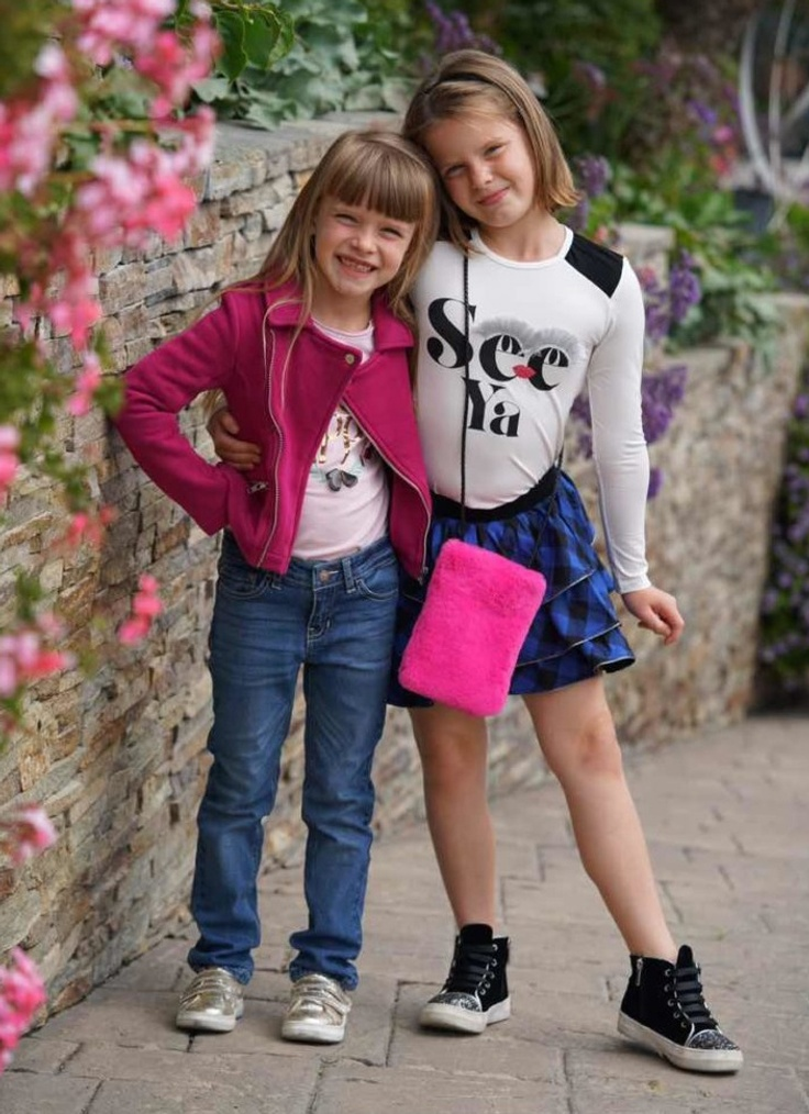 Two young girls wearing trendy clothing, accessories, and shoes from Kidpik