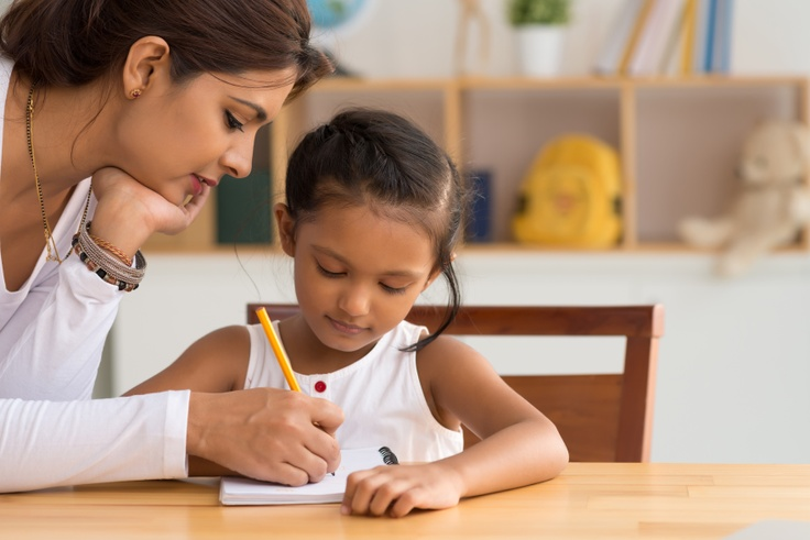 Girl and mom drawing