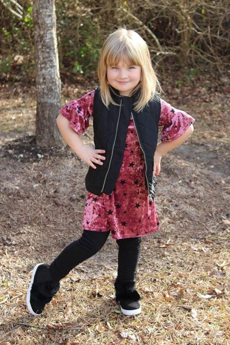 Girl in kidpik clothing outfit