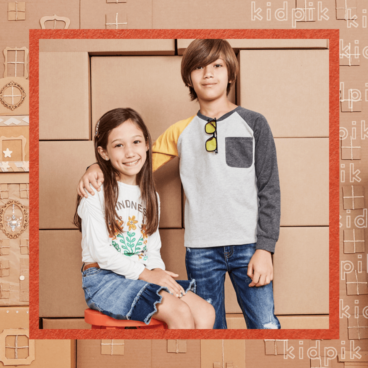 Boy and girl wearing subscription outfits