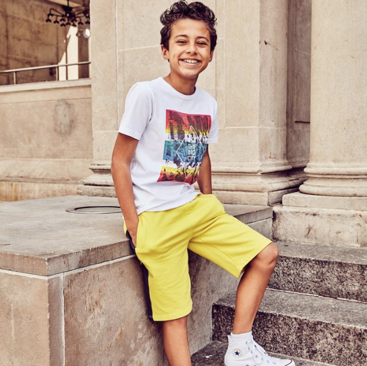 Boy in subscription clothes outfit