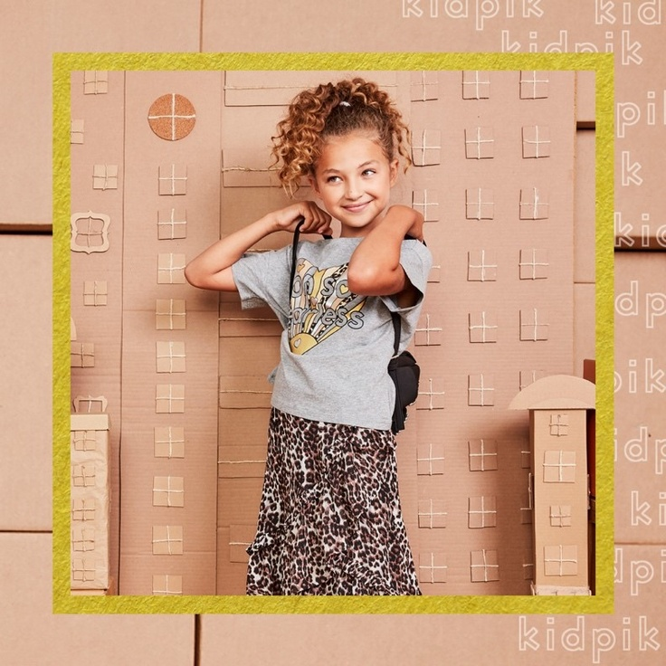 Girl standing while wearing kidpik clothes