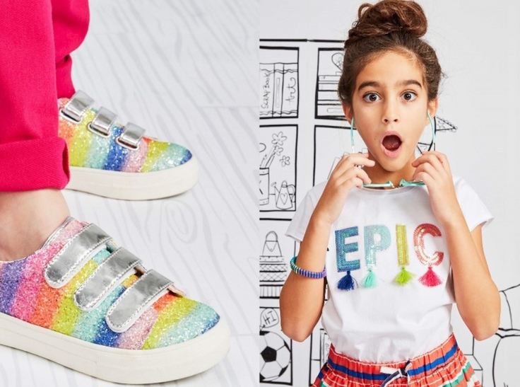 "Girl in ""Epic"" t-shirt and rainbow shoes"