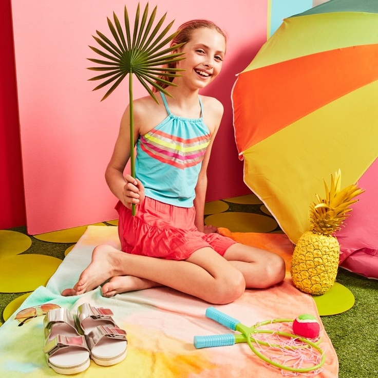 a girl in kids clothing subscription clothes