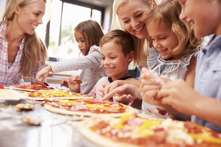 Kids making personal pizza