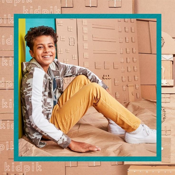 Boy sitting while wearing kidpik clothes